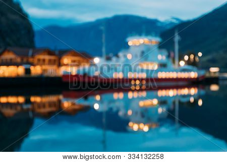 Flam, Norway. Touristic Ship Boat Moored Near Berth In Sognefjord Port. Summer Evening. Abstract Bok