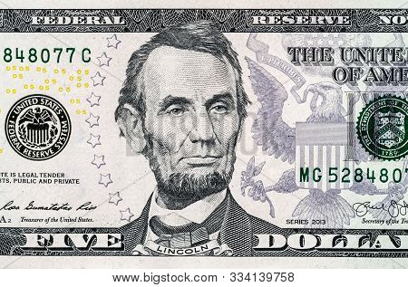 Close-up Portrait Of Abraham Lincoln On A 5 Us Dollars Banknote.