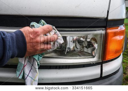 Man Hand With Rag Cleaning Front Headlights On Truck