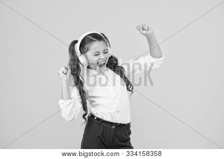 Singing In Tune. Cute Small Child Taking Her Singing Lessons On Yellow Background. Adorable Little G