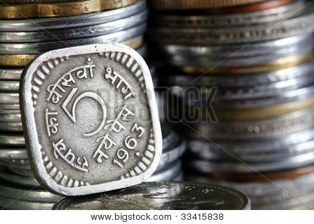 1963 printed 5 Paisa indian currency coin with stack of other coins in the background poster