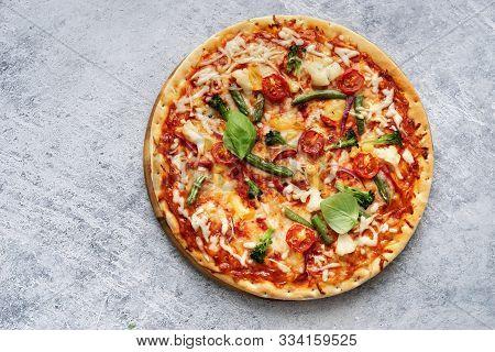 Homemade Vegetarian Pizza On Light Blue Background