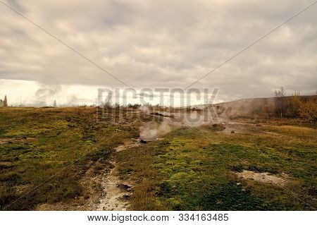 Geyser Natural Miracle. Steam Of Hot Mineral Source In Iceland. Iceland Famous For Geysers. Iceland