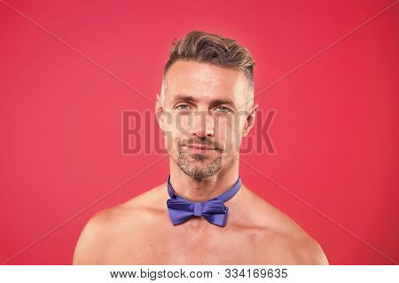 Bow Tie Only. Man Attractive Sexy Guy Bristle Face Naked Shoulders On Red Background. Private Party