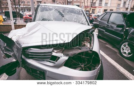 The Car After The Accident. Broken Car On The Road. The Body Of The Car Is Damaged As A Result Of An