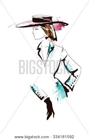 Fashion Woman In Hat On A White Background. Sketch. Fashion Model Posing. Hand Drawn Fashion Girl.
