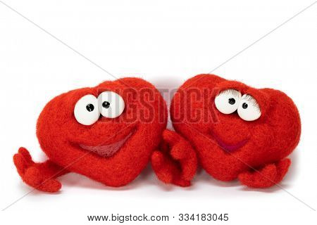 Two wool red hearts isolated on white background, symbol of love, healtcare, valentines day concept