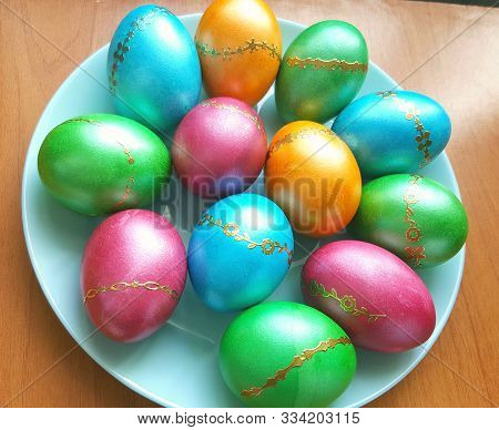 Colorful Easter Eggs On A Plate. Happy Easter Holiday. Many Decorated Easter Eggs Are Top View. Holi