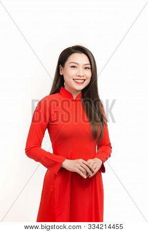 Lunar New Year celebrations. Portrait of Vietnamese woman dress in ao dai poster