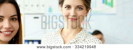 Portrait Of Pretty Female Looking At Camera With Great Joy And Calmness. Smiling Lady Holding Paper