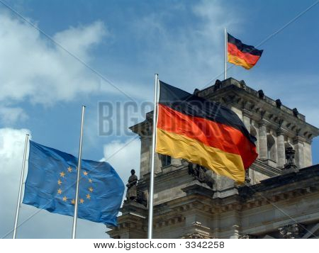 Flags At The Reichstag (German Parlament) In Berlin