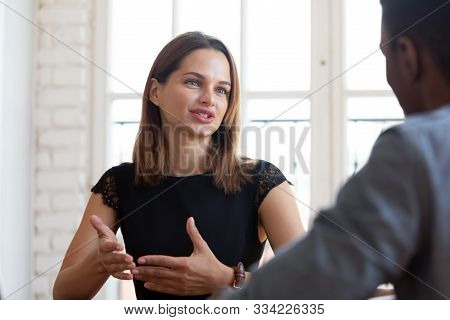 Happy Pleasant Young Female Financial Advisor Lawyer Explaining Contract Details.