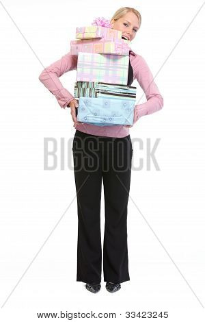 Full Length Portrait Of Woman Holding Stack Of Present Boxes