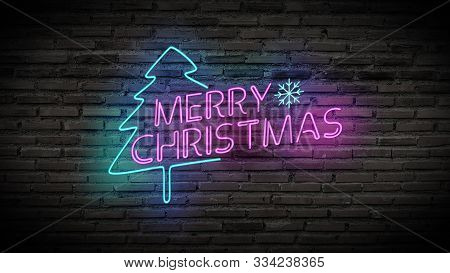 Merry Christmas Shiny Neon Lamps Sign Glow On Black Brick Wall. Colorful Sign Board With Text Merry