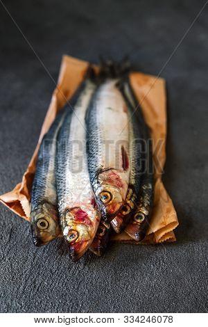 Raw Herring Fish On A Dark Background
