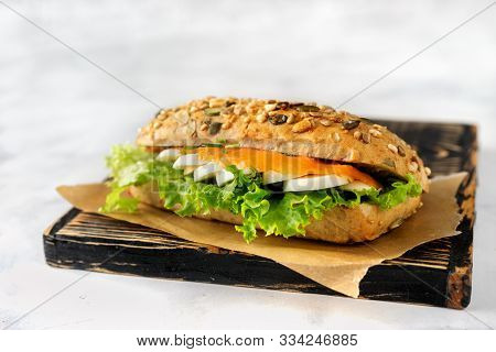 Healthy Sandwich With Salmon, Egg And Salad