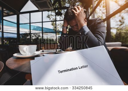 Termination Of Employment And Layoff Concept, Stressed Businessman Feeling Down After Received Termi