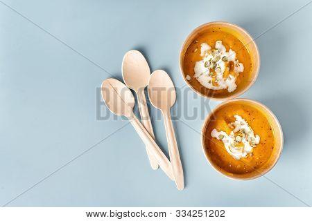 Top View Of Pumpkin Soup In Eco Craft Paper Tableware