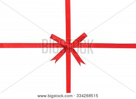 Red Ribbon And Bow Isolated On White Background With Clipping Path.