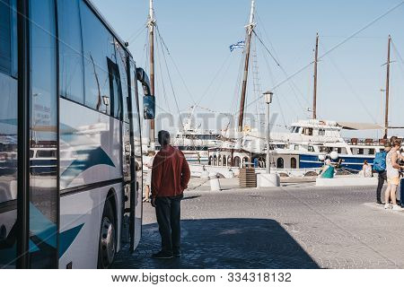 Mykonos Town, Greece - September 23, 2019: Man Waiting By The Bus At Bus Station Located In Old Port