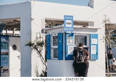 Mykonos Town, Greece - September 23, 2019: Man Buying Bus Tickets From A Fabrika Bus Station In Hora