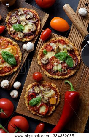 Healthy Comfort Food Or Keto Diet Concept. Cauliflower Gluten Free Pizzas With Mushrooms, Eggplants,
