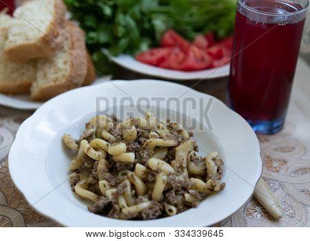 Tasty Dinner. Navy Pasta, Salad, Compote, Bread.tasty Dinner. Navy Pasta, Salad, Compote, Bread