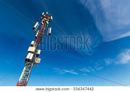 Telecommunication Tower Or Mast With Microwave, Radio Panel Antennas, Outdoor Remote Radio Units, Po