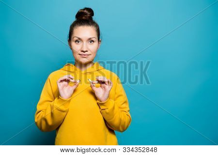 Girl In A Sweatshirt Holds A Broken Cigarette And Smiles, Copy Space