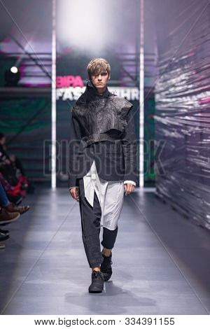 ZAGREB, CROATIA - OCTOBER 26, 2019: Fashion model wears clothes designed by roatian designer 'Spirit by T.B.' at the 'Fashion.hr' fashion show