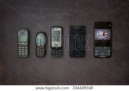 Layout Of Old Phones. Siemens, Samsung, Nokia, Iphone On A Gray Background. Russia, Tatarstan, Octob