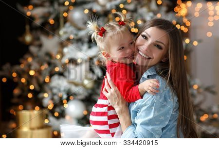 Family Celebrates Christmas. Happy Mother With Daughter In Magic Night. Gifts, Christmas Tree With Y