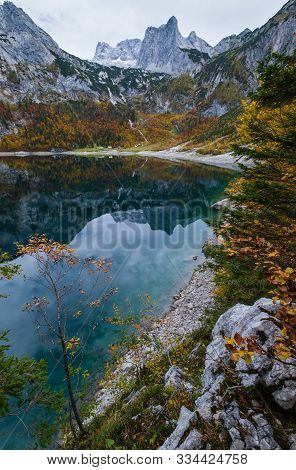 Picturesque Hinterer Gosausee Lake, Upper Austria. Colorful Autumn Alpine View Of Mountain Lake With