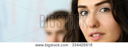 Portrait Of Attractive Businesswoman Looking At Camera With Gladness In Modern Conference Room And D