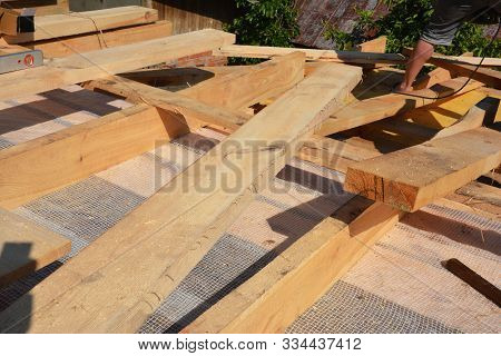 Roofing Construction Wooden Beams, Rafters, Trusses With Vapor Barrier, Insulation Against Leaking R