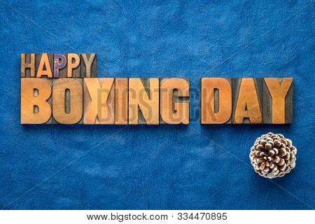 Happy Boxing Day word abstract in vintage letterpress wood type with pine cone, greeting card