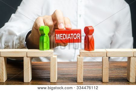 A Man Makes Contact Between People Opponents. Arbitrator And Mediator. Build Bridges, Seek A Comprom