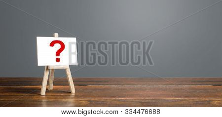 Easel With A Question Mark. Asking Questions, Searching For Truth. Curiosity, Learn And Improve. Mys