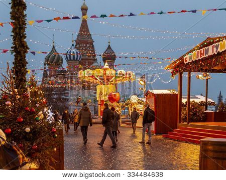 Moscow, Russia, 04 december 2018: Celebration of the New Year and Christmas on the Red Square in the center of Moscow. Holiday fair and amusement park near the Kremlin.