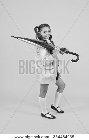 Rain Forecast On September 1. Cute Schoolgirl In Raincoat With Umbrella On September 1. Small Child