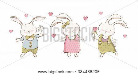 Set Of Cute Cartoon Easter Bunnies In Vector. Little Rabbit Boy And Girl. Hand Drawn Style. Kawaii F