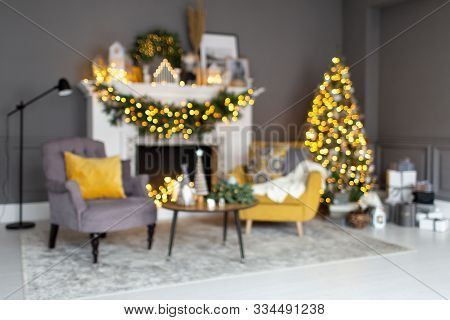 Blured Photo Of Living Room Decorated For Christmass With Christmass Standing Near Fireplace