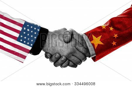 Print Screen Of Usa And China Flag On Shirts Of Businessman Hand Shaking.it Is Symbol Of Economic Ta