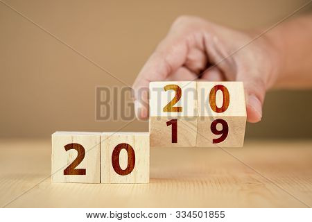 Hand Flip Wooden Cube For New Year Change 2010 To 2020. New Year Change And Starting.