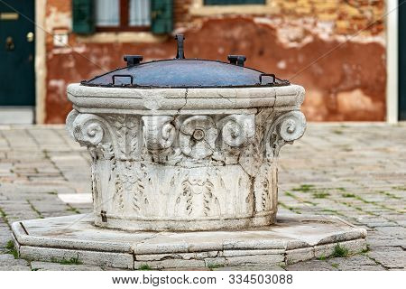 Venice, close-up of an ancient marble well for rainwater, Campo della Maddalena, UNESCO world heritage site, Veneto, italy, Europe poster