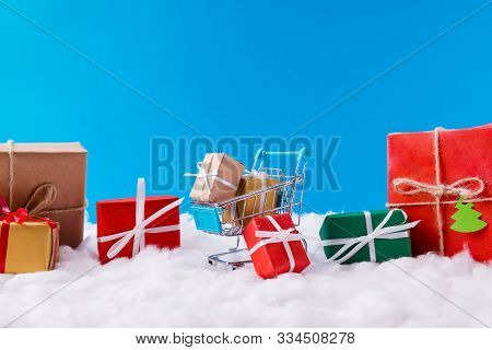 Many X-mas Small Red Green Yellow Brown Gift Boxes Stay Inside Supermarket Trolley X-mas Time Christ