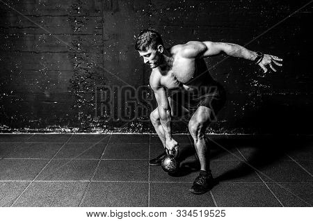 Kettlebell Swing, Young Strong Sweaty Focused Fit Muscular Man With Big Muscles Holding Heavy Kettle