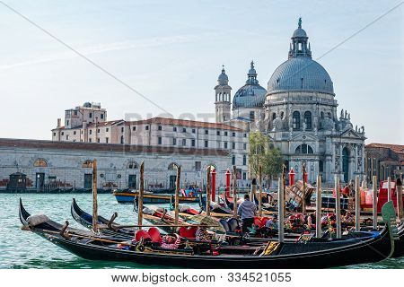 Venice, Italy - October, 2019: Picturesque View Of Gondolas On Canal Grande With Basilica Di Santa M