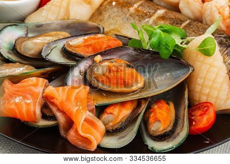 Roasted Mixed Seafood Contain Mussels, Prawns, Salmon, Calamari Squids And Grilled Barracuda Fish Ga