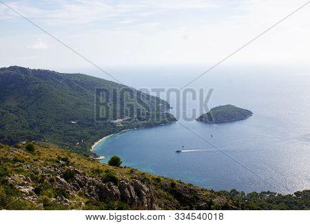 View Of Coast With Boat Sailing At Mirador Es Colomer, Mallorca, Spain 2018. Beautiful Sea, Mallorca